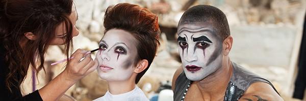 Makeup artist working clown eyeliner for performers